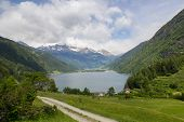 stock photo of engadine  - Lago di Poschiavo is a natural lake in the Poschiavo valley in the canton of Grisons Switzerland - JPG