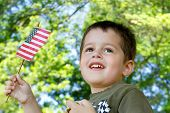 Little boy waving an American flag