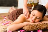 picture of massage oil  - Chinese Asian woman in wellness beauty spa having aroma therapy massage with essential oil - JPG