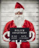 image of delinquency  - Mugshot of Santa Claus criminal under arrest - JPG