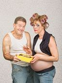 foto of hillbilly  - Guilty pregnant woman eating candy with smiling man - JPG