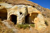 pic of cave-dweller  - Probably the best known feature of Cappadocia, Turkey found in its very heart, are the fairy chimneys of Goreme and its surrounding villages ** Note: Shallow depth of field - JPG
