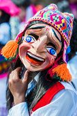 PISAC, PERU - JULY 16: man dancer portrait at Virgen del Carmen parade in the peruvian Andes at Pisa