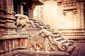 stock photo of trichy  - Amazing stone bas relief on stepladder of main tower at Hindu Brihadishvara Temple - JPG