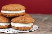 stock photo of pumpkin pie  - Stack of homemade Pumpkin Whoopie Pies or Moon Pies made with cream cheese frosting - JPG