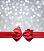 pic of ribbon bow  - Christmas silver bokeh background with red bow - JPG