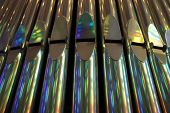 foto of pipe organ  - the front view of silver organ pipes.