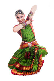 stock photo of bharatanatyam  - Bollywood dancer in green and orange folded dress posing as cobra - JPG