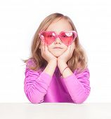 Girl wearing pink heart shape glasses