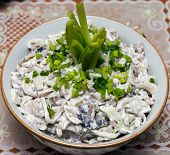 Squid salad with mushrooms and green peas