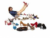 stock photo of platform shoes  - Studio shot of young woman and huge selection of women - JPG