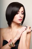 picture of bangles  - Beautiful makeup short black hair woman with bangle on the hand - JPG