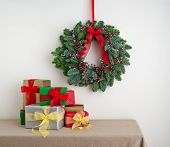 Advent Wreath Over Side Board With Present