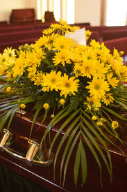 picture of funeral  - Flowers from the family on a casket at a funeral - JPG