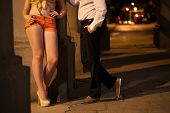foto of hooker  - Man talking with prostitute on the street - JPG