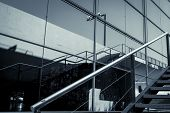 stock photo of bannister  - detail of a glass facade with reflection and handrail - JPG