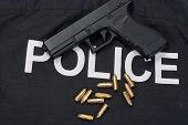 picture of ammo  - 9mm handgun with ammo on police uniform - JPG