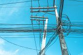 foto of utility pole  - image of electric pole and blue sky on sunny day - JPG