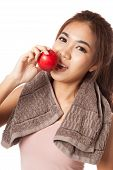 stock photo of love bite  - Asian healthy girl smile bite red apple isolated on white background - JPG