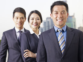 stock photo of japan girl  - portrait of an asian business team focus on the man in front.