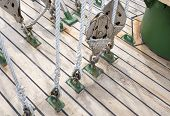 stock photo of pulley  - the many Yacht Pulley Blocks and Ropes - JPG