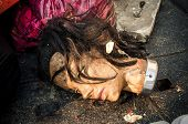 picture of hairline  - Dirty mannequin doll head was left in a garbage dump  - JPG