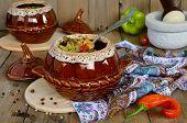 stock photo of pot roast  - A pot of chicken and mushrooms - JPG