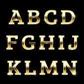 stock photo of glitter  - Golden glittering metal alphabet - JPG