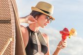 stock photo of frappe  - young beautiful woman enjoying summer vacation - JPG