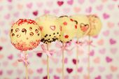 picture of cake pop  - Tasty cake pops on color background - JPG