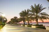 stock photo of emirates  - Promenade in Abu Dhabi illuminated at dusk United Arab Emirates - JPG