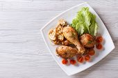 picture of fried chicken  - Fried chicken legs with mushrooms and tomatoes on a plate - JPG