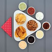 stock photo of crisps  - Crisp and dip party food selection in porcelain bowls - JPG