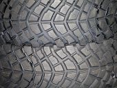 stock photo of four-wheel drive  - Four wheel drive tire stack as a background - JPG