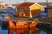 stock photo of fjord  - Small orange motorboat reflecting in the water - JPG