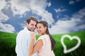 stock photo of shoulder-blade  - Attractive young couple smiling at camera against green field under blue sky - JPG