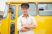 image of bus driver  - Smiling bus driver looking at camera outside the elementary school - JPG