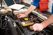 pic of garage  - Mechanic using diagnostic tool on engine at the repair garage - JPG
