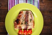 pic of pangasius  - Dish of Pangasius fillet with rosemary and cherry tomatoes in plate on wooden table background - JPG