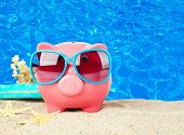 picture of piggy  - Piggy bank on beach background - JPG