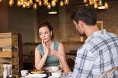 image of argument  - Young couple having an argument at the cafe - JPG