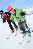 picture of daddy  - Daddy with young boy skiing down ski slope - JPG