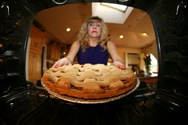 picture of grandmother  - Sweet retro grandmother holding a freshly baked lattice top apple pie - JPG