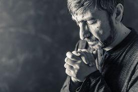 stock photo of pray  - man closed his eyes to pray - JPG