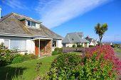 stock photo of english cottage garden  - Sunny Houses in Cornwall - JPG