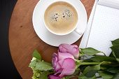 stock photo of coffee coffee plant  - Coffee table with a cup of coffee and flowers - JPG