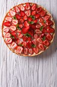 foto of tarts  - Delicious tart with fresh strawberries and soft cheese on the table - JPG