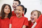 image of drama  - Group Of Children Enjoying Drama Class Together - JPG