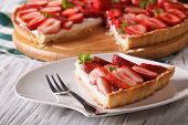 pic of tarts  - a piece of strawberry tart with cream cheese on a plate close - JPG