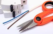 stock photo of wire cutter  - Cable cutter electric wire and fuse lying on white background accessories for engineer jobs repair of cable - JPG